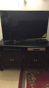 Flat plasma TV with the stand Ashley furniture stand TV and DVD and stand all for $875 15 km