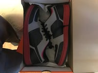 pair of black-gray-and-red low-top sneakers with box
