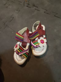 toddler's pair of white-and-red sandals