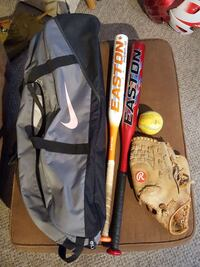 white and red Easton baseball bats with grey Nike duffel bag