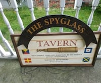 Wooden sign the spyglass tavern West Indies very old age rum by the bo