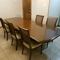 rectangular brown wooden table with 8 chairs di Houston, 77038