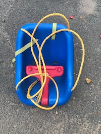 blue and red Little Tikes swing chair Watchung