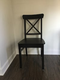 two black wooden armless chairs