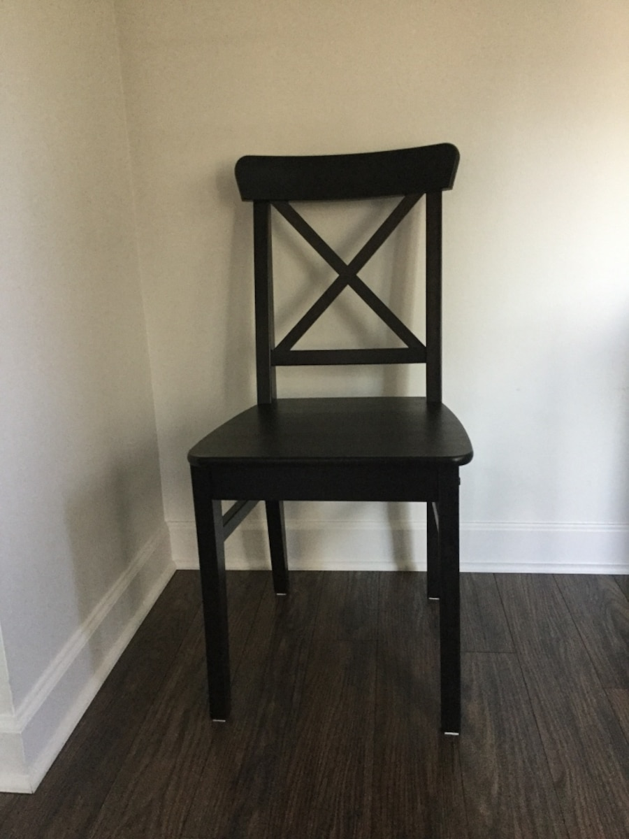 two black wooden armless chairs - Fort Dearborn