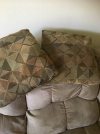 Two gray suede throw pillows