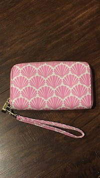 women's pink and white leather wristlet
