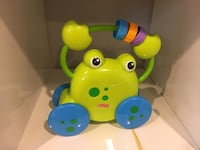 Green and blue fisher-price walking frog. Stafford, 22554