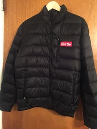 black and red full-zip puff jacket with Hustle patch