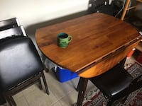 Four chairs and table solid wood Calgary, T2X 1E4