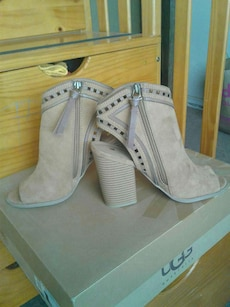 gray suede open toe boots on box