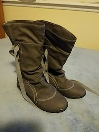 pair of gray suede round-toe mid-calf boots