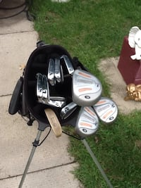 Black and gray golf bag with golf clubs . Ladies right handed set. (26)