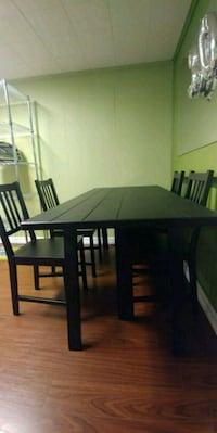 rectangular brown wooden table with four chairs di 543 km