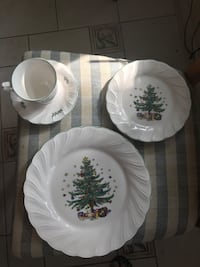 8 pl. settings. Christmas dishes new in box.