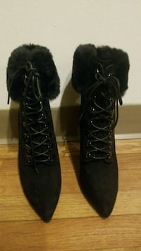 pair of black suede fur-line point-toe heeled boot