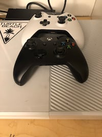 white Xbox One with two game controllers, Negotiable  Montréal, H8Y