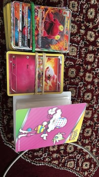 pink and white Nintendo 3DS with game cases Surrey, V3S 3E7