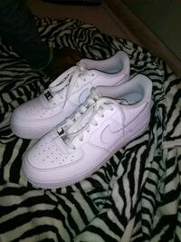pair of white Nike Air Force 1 low shoes Buffalo