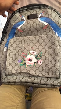 Monogrammed brown gucci floral paint backpack