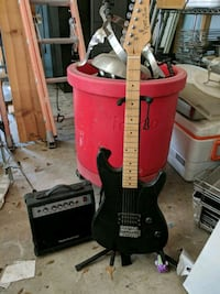 red and black electric guitar North Augusta, 29841