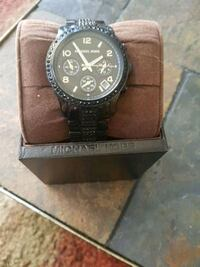 round black-colored chronograph watch with link b Calgary, T2Z 2K4