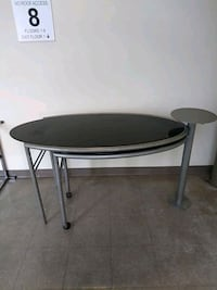 glass top table/opens into two tables