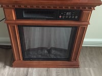 Brown wooden framed electric fireplace Rockville, 20852