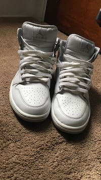 Pair of white Air Jordan 1 mid-high sneakers Cleveland, 44119
