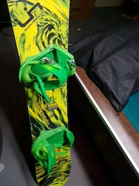 green and black snowboard with bindings 3499 km