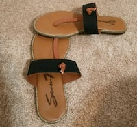 pair of brown-and-black leather sandals 833 mi
