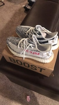 Pair of white adidas yeezy boost 350 on box District Heights, 20747