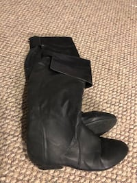 Pair of women's black leather knee-high boots Winnipeg, R3J 3A3