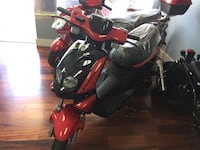 red and black motor scooter Miami, 33133