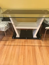 Glass top table. Comes with 6 chairs. Delivery offered Montgomery Village, 20886