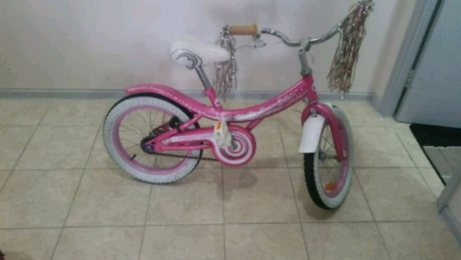 toddler's pink and white bicycle 654fd4ff-2853-4190-a04d-4f62f965bf2f