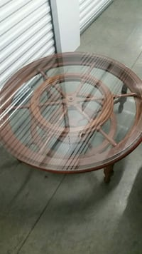 Glass top wooden table with ship wheel  Mesquite, 75149