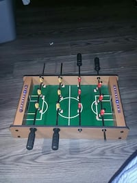 brown and green wooden foosball table