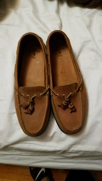 pair of brown leather loafers 547 km