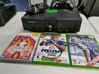 black Xbox 360 console with controller and game cases Clinton, 84015
