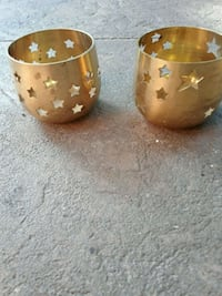 Lacquered brass candle holders .