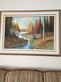 rectangular brown wooden-framed river with forest painting