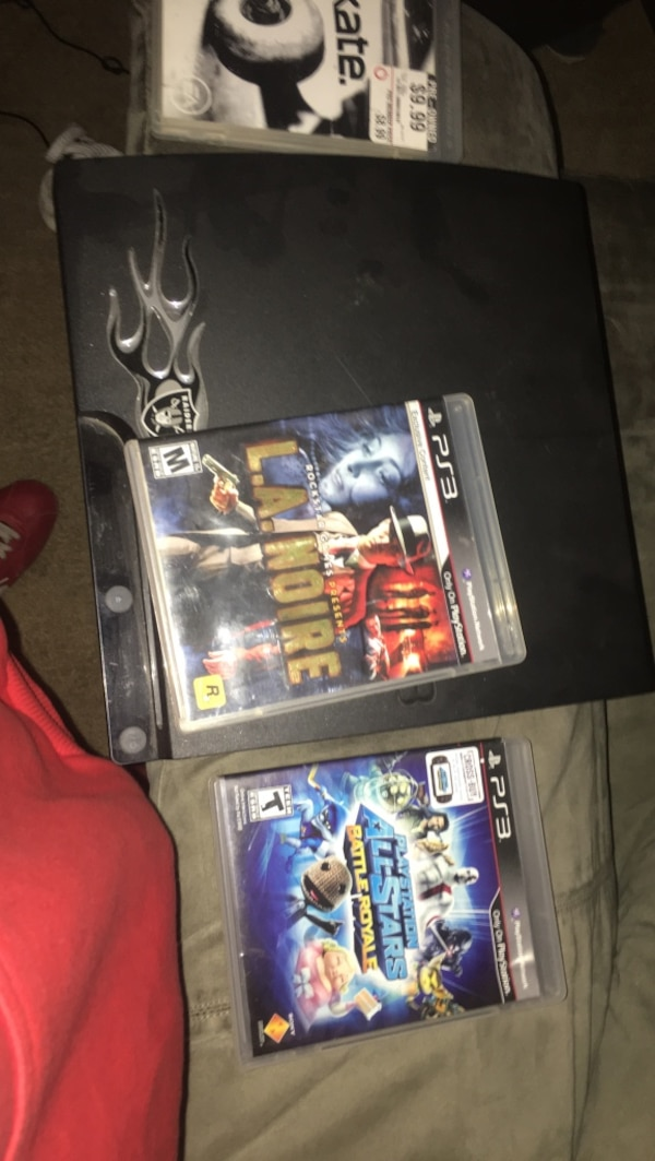 two Sony PS3 Slim and game cases
