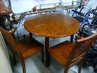 round brown wooden table with four chairs dining set Rockville, 20850