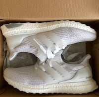 pair of white Adidas Ultra Boost shoes