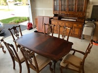 Rectangular brown wooden table with eight chairs dining set Gainesville, 20155