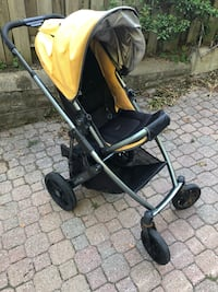 Uppababy Vista stroller, 2011. Black metal with yellow accents.