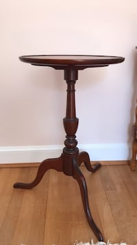 brown wooden pedestal table with black metal base Washington, 20015