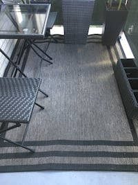 Grey and black outdoor rug. Great condition very durable  Toronto, M3B 2V8
