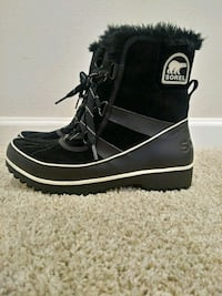 pair of black-and-white Sorel duck boots Leesburg, 20176